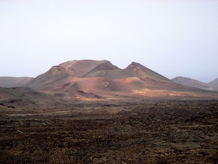 Mountain set in a sea of volcanic residue Stock Photo - 534600