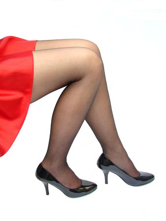 Sexy Legs sitting in a red skirt and stiletto heels