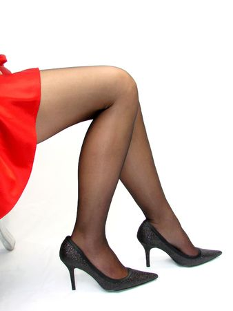 stockings feet: Sexy Legs Sitting in a Red Skirt