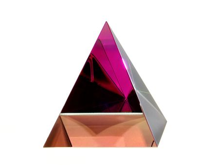Ornamental Glass Pyramid with Colour Reflections on white