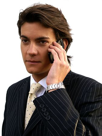 young man in business suit with cellphone Stock Photo