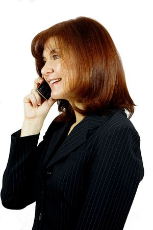 Female model in a business suit talking on a mobile phone