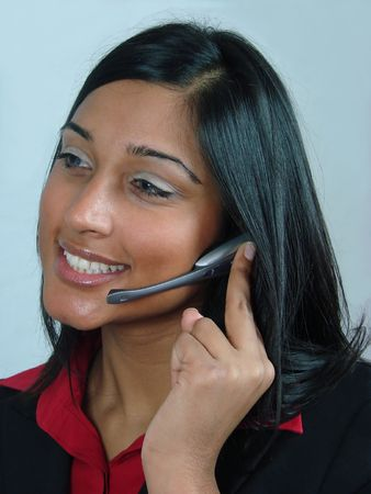 Asian Girl talking into a telephone headset