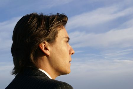 Business Person looking away from  the camera into the Sunset