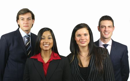 Business Team of four young smiling people Stock Photo