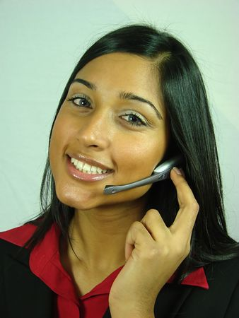 Smiling Asian Girl wearing a Telephone Headset Stock Photo