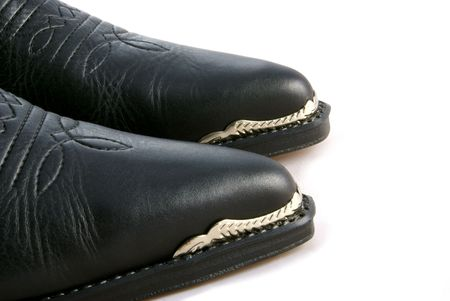 A pair of cowboy boots with metal toe caps