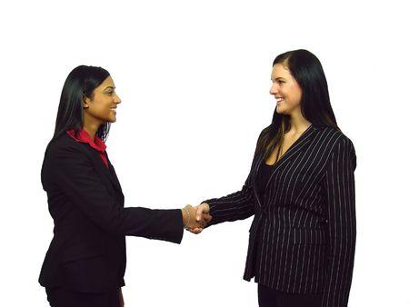 Two Businesswomen shaking hands Stock Photo