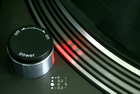 Red strobe light on record player turntable