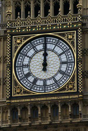 Face of Big Ben in London at 12 o'clock Midday