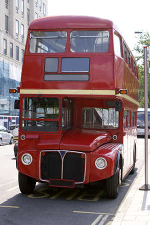 Vintage Red London Bus at a Bus Stop