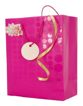 Pink Carrier Bag with ribbons and blank gift tag suggesting a Gift for a female