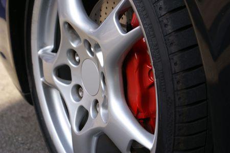 brake caliper: Alloy Wheel in Profile on Expensive Sports Car (focus on brake caliper)