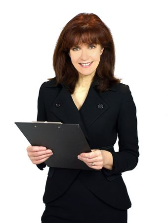 Woman holding a clipboard smiles at the camera