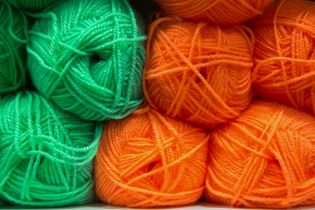 Balls of wool in orange and green colours