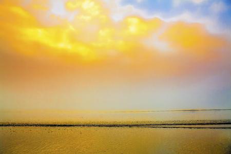oceanscape: Sunrise foggy seaside beach seascape Stock Photo