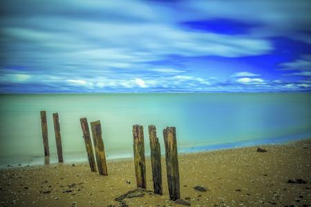 oceanscape: Long exposure cloudy seaside beach seascape