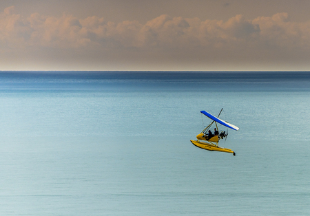 monoplane: Flying boat high above ocean seascape Stock Photo