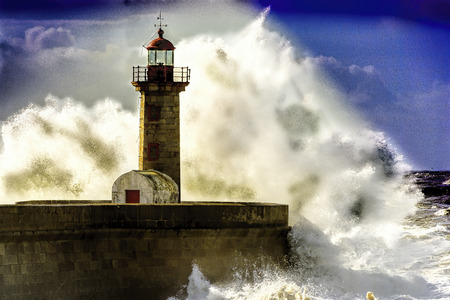 Porto lighthouse under attack by Atlnatic Ocean waves Stock Photo