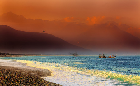 fighter jet: Taiwanese F16 fighter jet, Chinese fishing junk with colorful sunrise and fog shrouded mountains