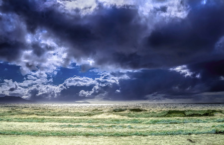choppy: Seascape with choppy seas and puffy clouds