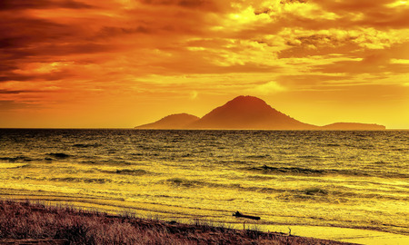 Volcano island sunset seascape