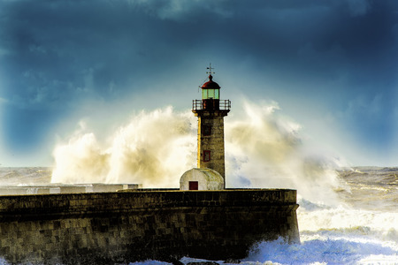 oceanscape: Porto lighthouse with huge waves in background Stock Photo