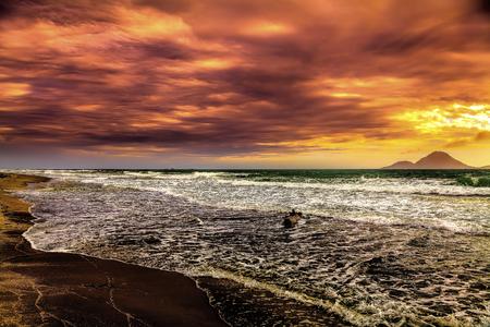 Virgin Kiwi beach with volcano isalnd in background