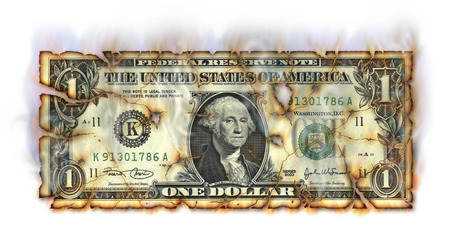 Photo Illustration of a U.S. one dollar bill retouched crumbling and burning. Stock Photo