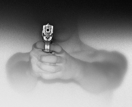Photo illustration of a man holding and aiming a gun.