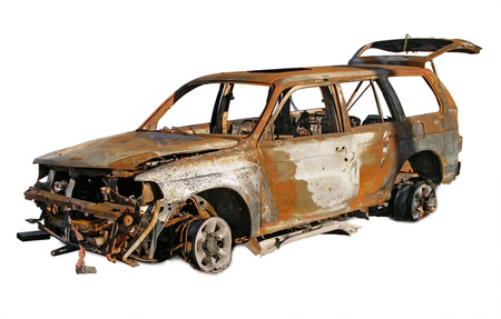 burned out: Photo illustration of a burned and rusted out car. Stock Photo