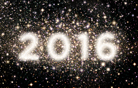 Against a star filled night sky, the year 2016 is created out of clusters of stars. 版權商用圖片
