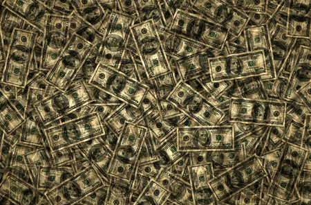 Background of fifty and one hundred dollar bills. Stock Photo