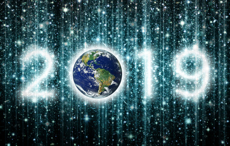 The year 2019 is created out of clusters of stars and against a star filled night sky with verical strings of light. 3D illustration. Stock Photo