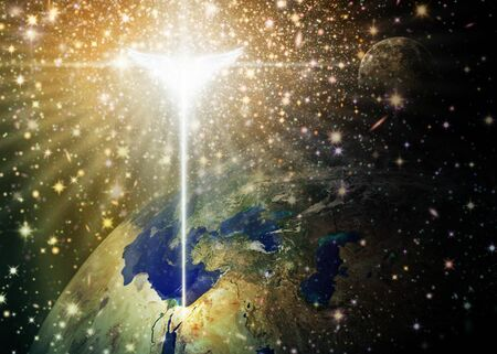 Digital illustration of the Christmas star and angel shining down over Bethlehem, as viewed from outer space. Space and stars are digitally illustrated. Credit NASA for earth and moon images. Stock Photo