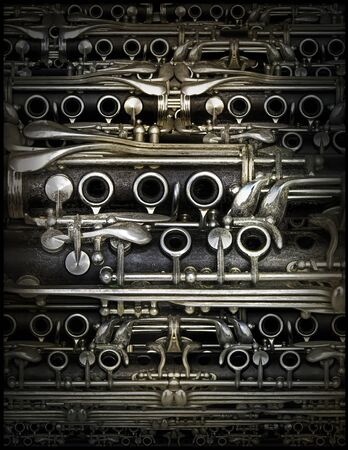 Parts of a clarinet used repeatedly to completly fill a background pattern. Archivio Fotografico