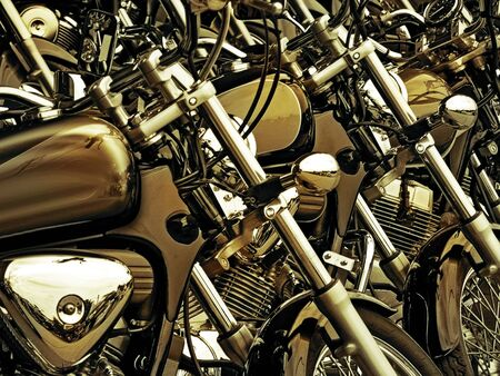 Similar style motorcycles parked side by side. Colors changed to rich golden tones.