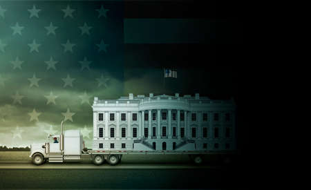 The White House on a flat bed truck, being driven from darkness into the light, with U.S. flag filling the sky. 3D Illustration Stock Photo