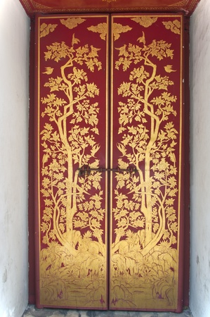 Thai painting art in the door of the temple photo