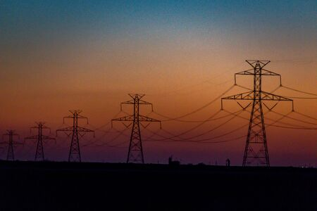 Scenery of silhouetted electrical power lines and tower during sunset. Reklamní fotografie