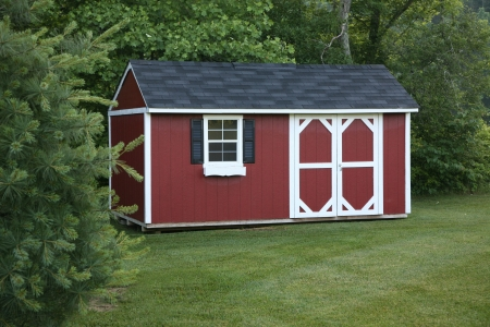 Lawn storage shed in a landscaped area