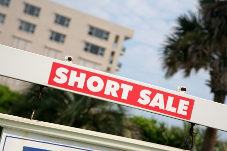 sales bank: Real estate sign advertising a short sale Stock Photo