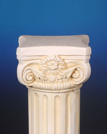 Greek column on a blue background photo