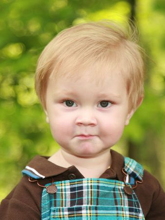 12 month old: Adorable 12 month old boy with a serious or perplexed expression on his face. Stock Photo