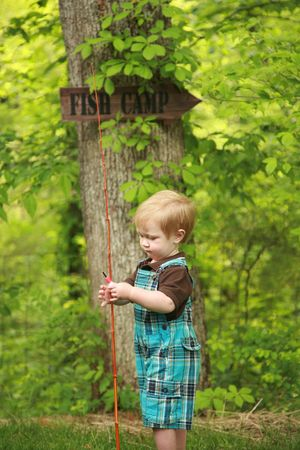 Focus on a toddler holding his first fishin pole with a Stock Photo - 5429569