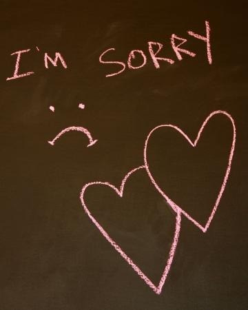 """나는 """"슬픈""""얼굴과 얽힌 마음으로 칠판에 글을 써 죄송합니다. 스톡 콘텐츠 - 5513253"""