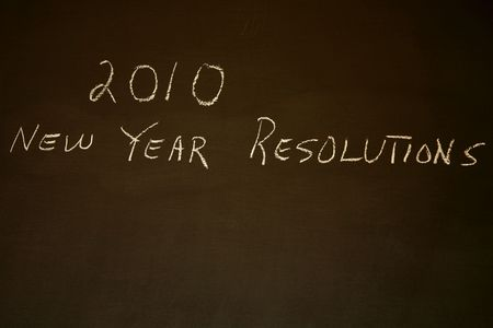 new year's resolutions: 2010 New Years Resolutions written on blackboard with copy space Stock Photo