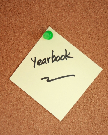 yearbook: Yearbook written on anote stuck to corkboard