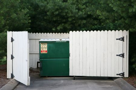 receptacle: Trash removel site at a retail business