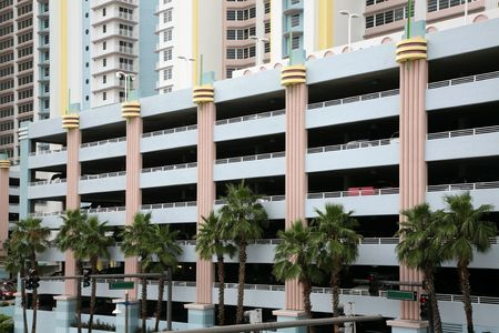 multi story car park: High end residential development includes a parking deck with an Art Deco theme.